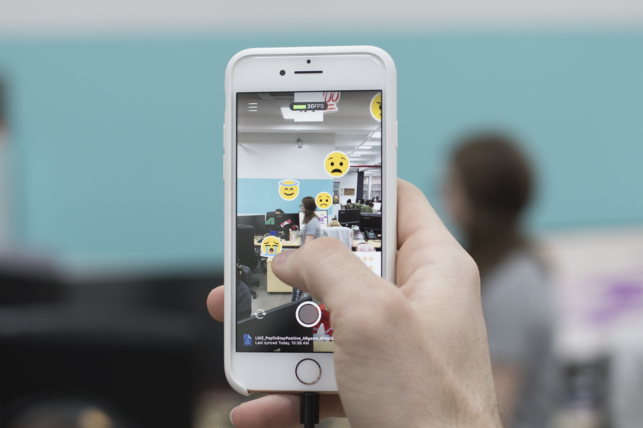 Our Augmented Reality Facebook Game Helps Users Focus on the Positive